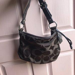 Coach shoulder bag and coordinating wallet.